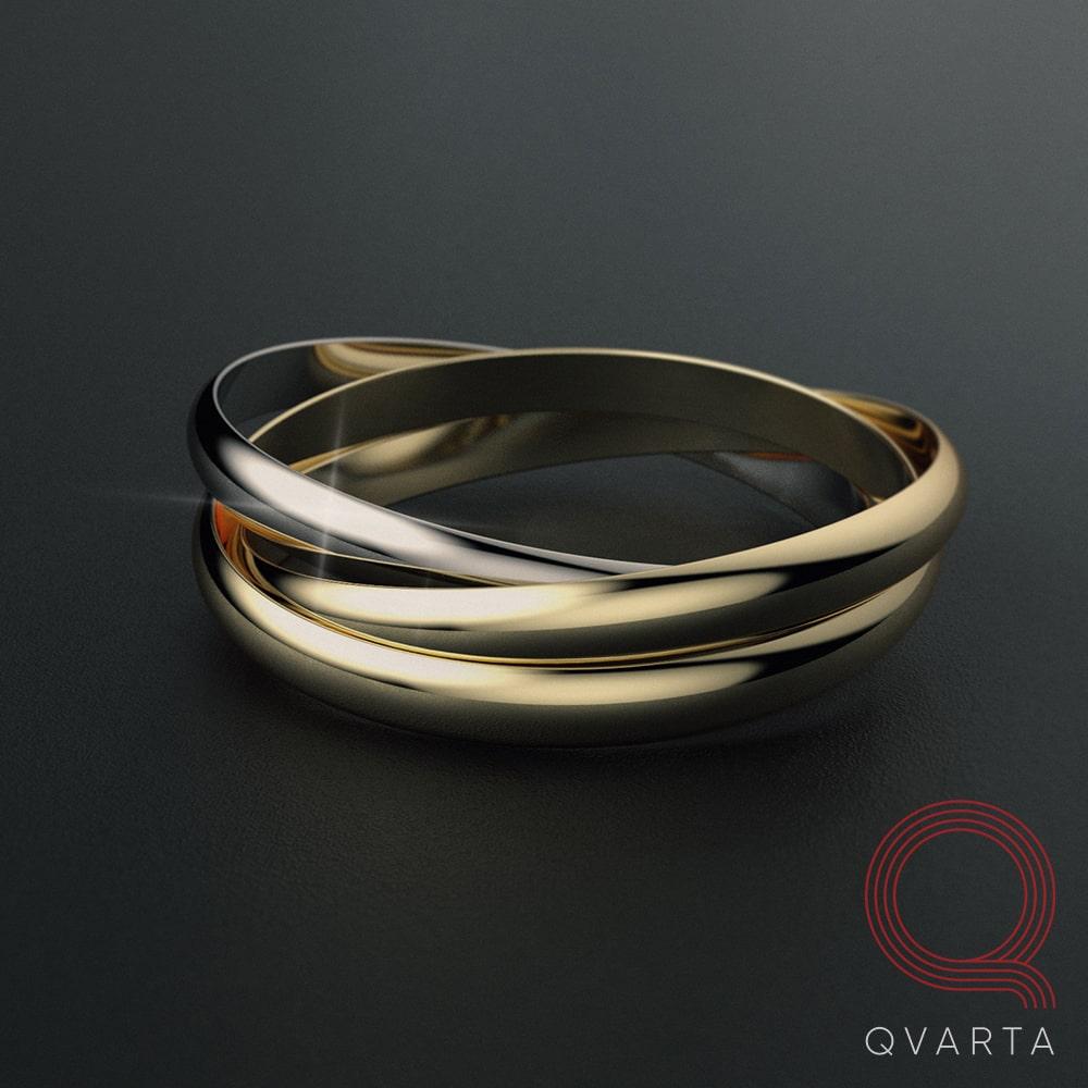Фото кольца с лого Qvarta лежащее на столе.